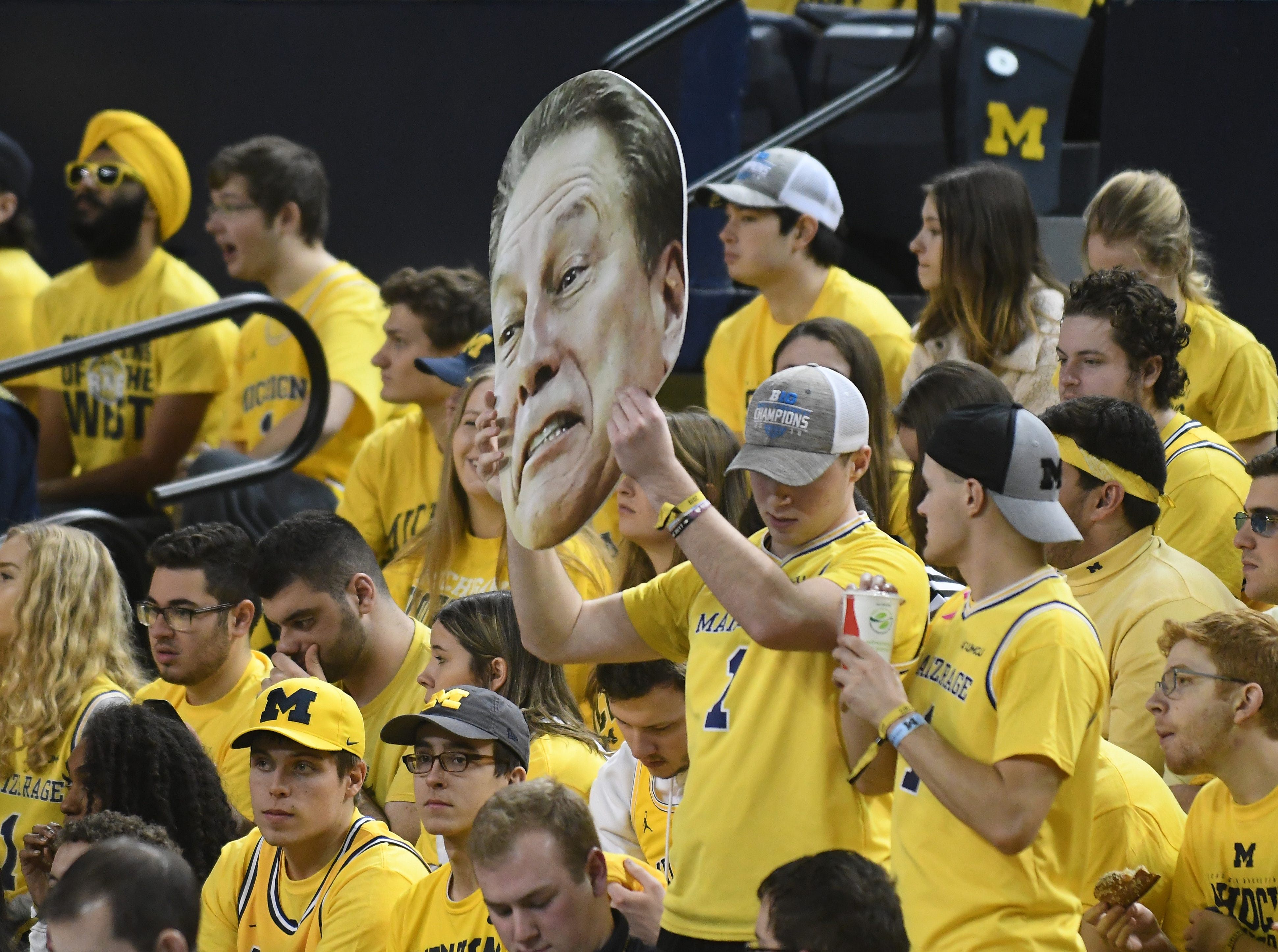 Michigan State head coach Tim Izzo's head floats amongst the Michigan fans in the Maize Rage before the game.