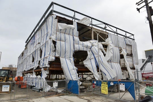 The exterior cover of the Detroit Pistons practice facility is blown out and ripped off in many areas of the building as high winds hit the Metro Detroit area on Sunday, February 24, 2019.