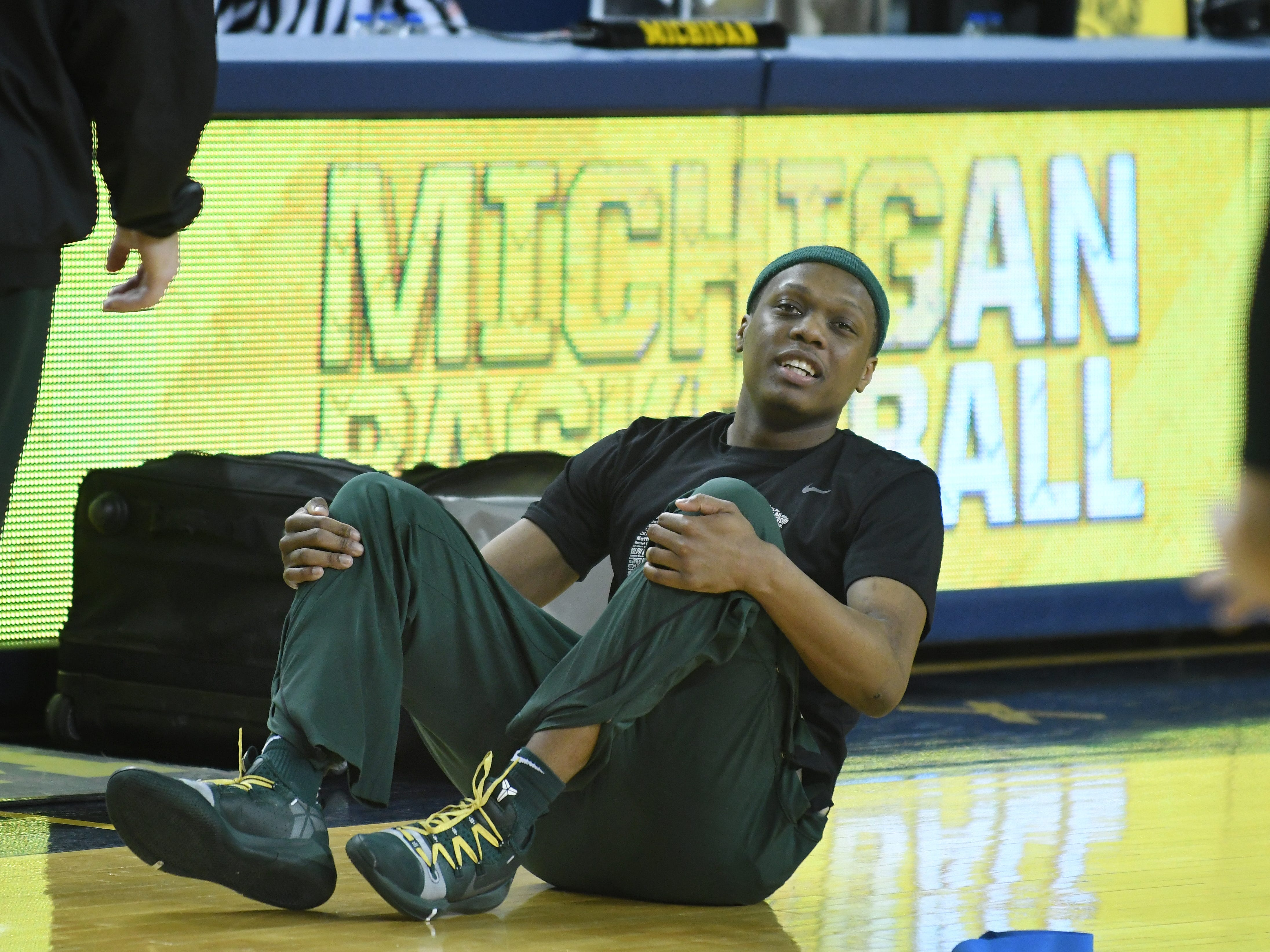 Michigan State's Cassius Winston stretches before taking on Michigan at Crisler Center in Ann Arbor, Michigan on February 24, 2019.