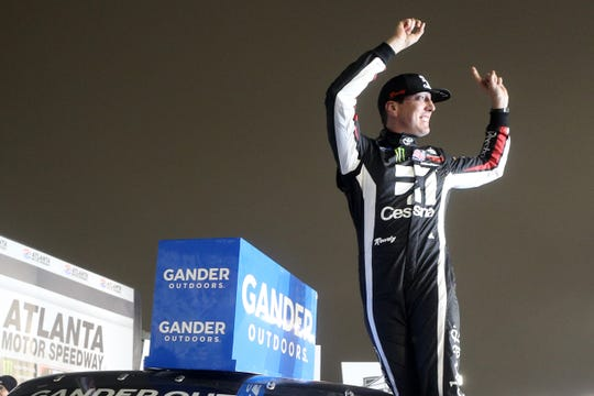 Kyle Busch, driver of the No. 51 Toyota, celebrates Saturday in victory lane after winning the NASCAR Truck Series Ultimate Tailgating 200 at Atlanta Motor Speedway.
