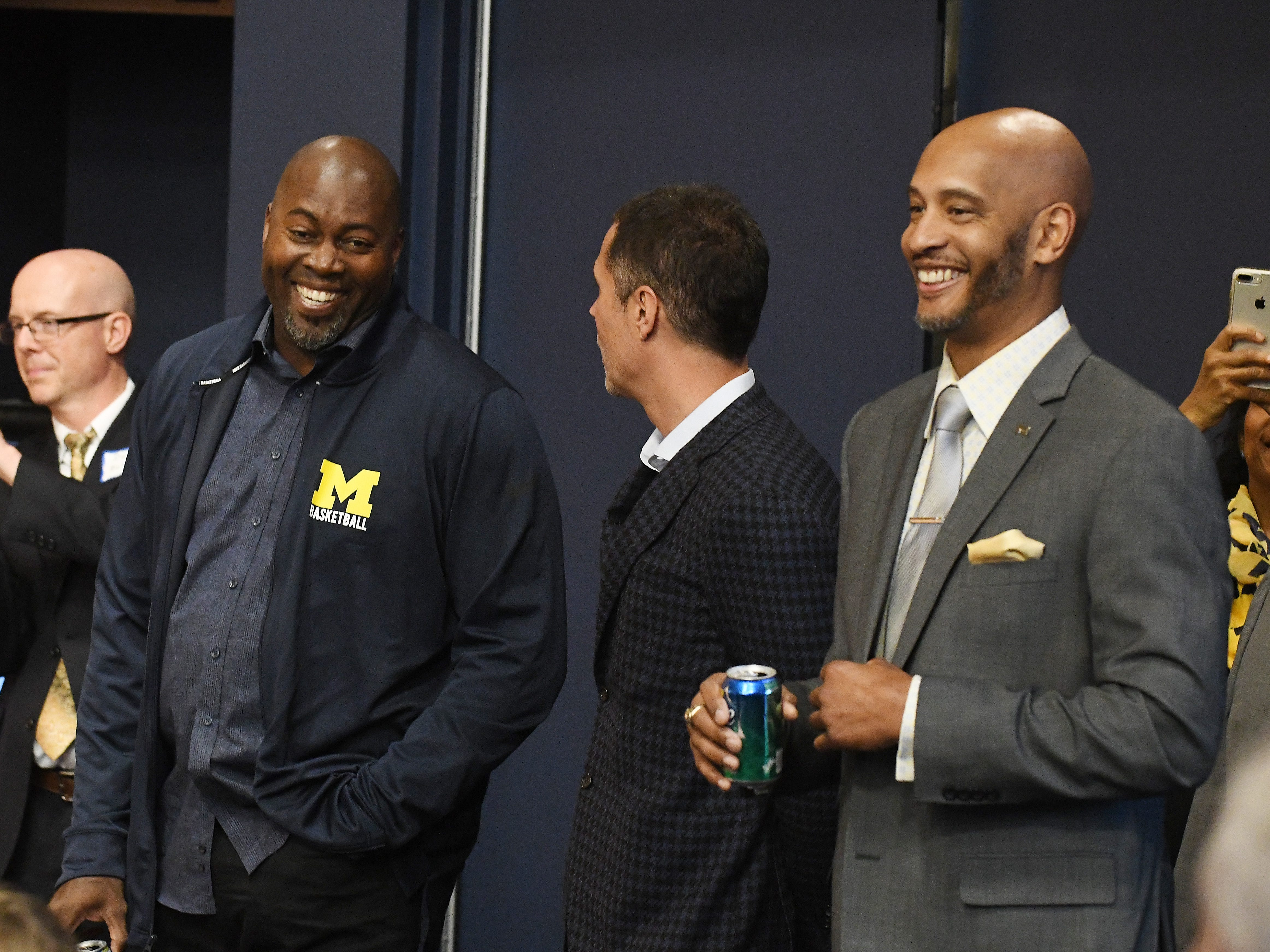 Members of the 1989 NCAA Championship team Glen Rice, Rob Pelinka and Sean Higgins during a pregame press conference.