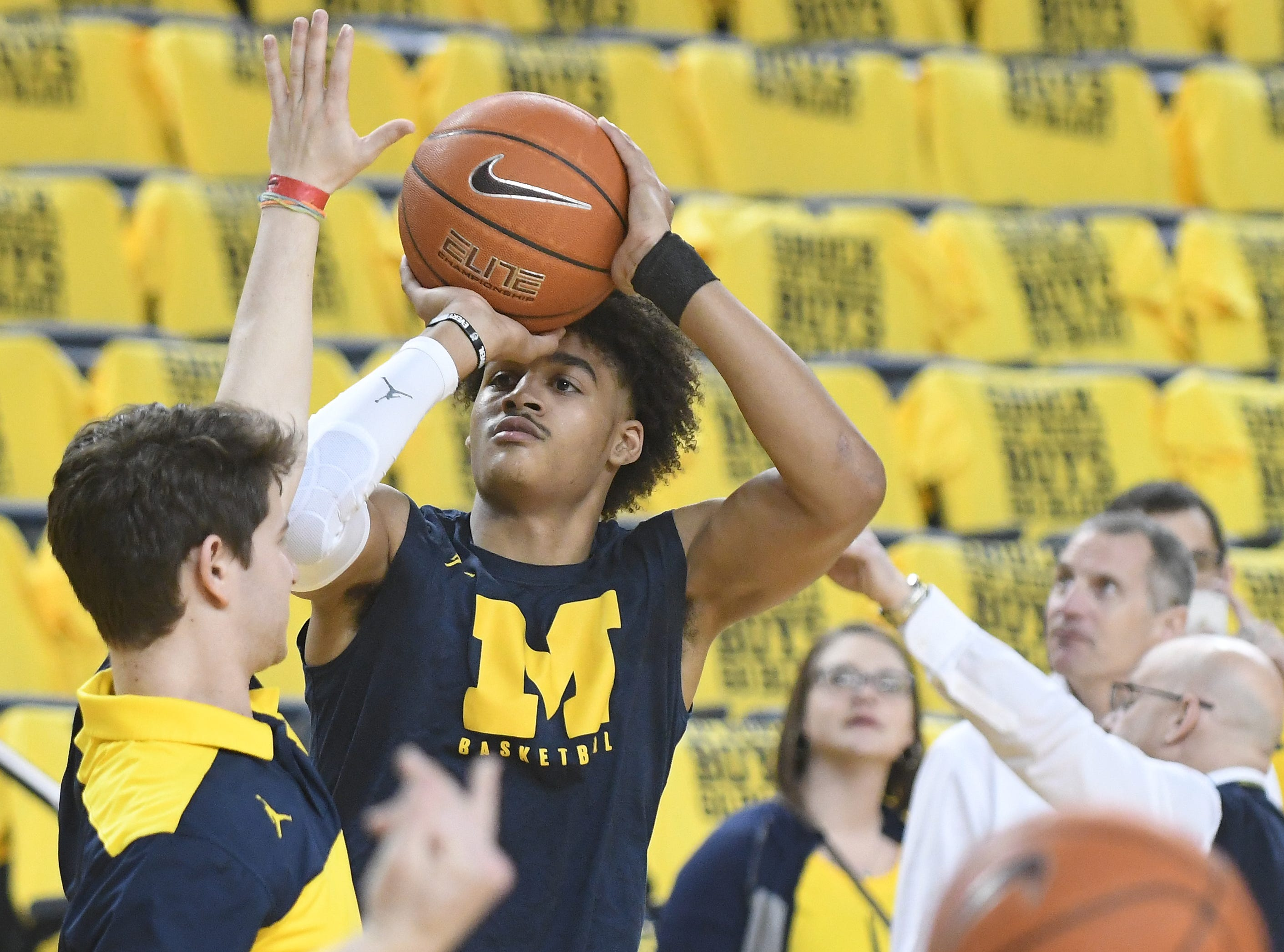Michigan's Jordan Poole warms up before taking on Michigan State at Crisler Center in Ann Arbor.