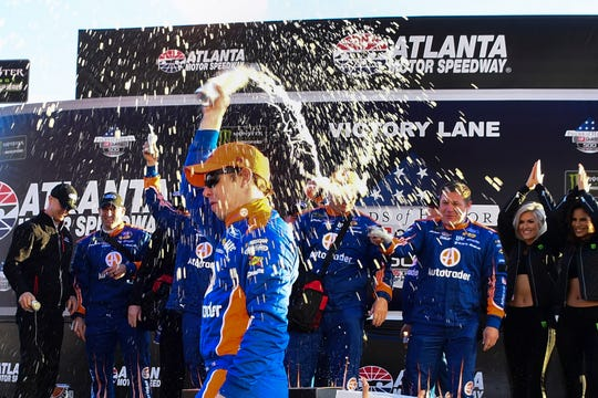 Brad Keselowski of Rochester Hills celebrates in victory lane after winning a Monster Energy NASCAR Cup Series auto race at Atlanta Motor Speedway
