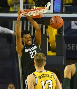 Michigan State's Xavier Tillman slams home two points late in the second half.