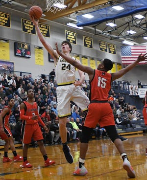 Junior center Matt Nicholson averages a double-double for Clarkston, at 13.6 points and 12.6 rebounds per game.