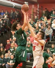 LaRon Boykin of Newfield shoots over Spencer-Van Etten's Nathan Mack during a Section 4 Class C boys quarterfinal on Feb. 23, 2019 at S-VE.