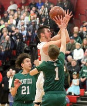 Nathan Mack of Spencer-Van Etten shoots in between Newfield's LaRon Boykin (21) and Jacob Humble (1) during a Section 4 Class C boys quarterfinal on Feb. 23, 2019 at S-VE.
