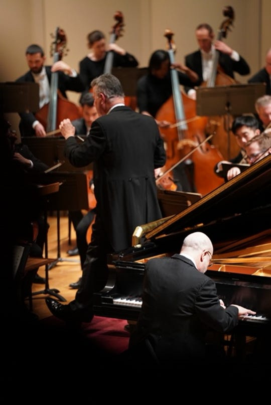 "Pianist Norman Krieger performs during Evansville Philharmonic Orchestra's ""Brahms and the Birds"" performance Saturday."