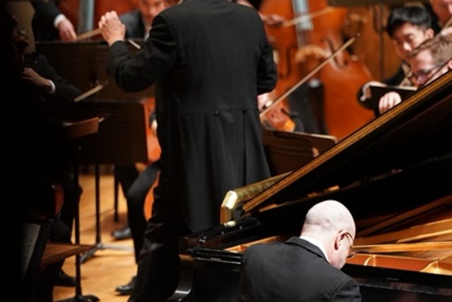 """Pianist Norman Krieger performs during Evansville Philharmonic Orchestra's """"Brahms and the Birds"""" performance Saturday."""