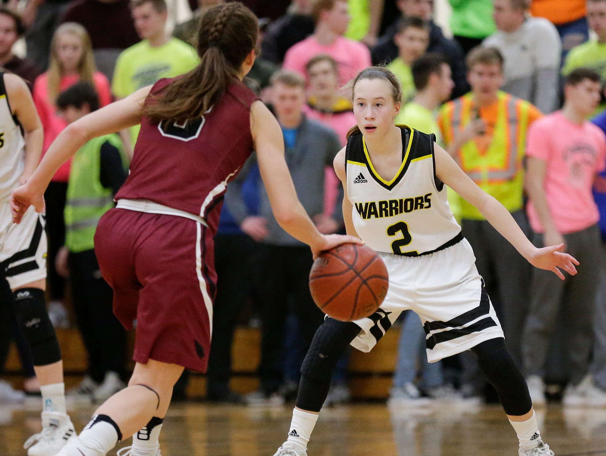 Waupun High School girls basketball's Naomi Aalsma (2) defends Mayville High School's Amber Schraufnagel (3) Saturday, February 23, 2019 during their WIAA Division 4 sectional quarterfinal game in Waupun. Waupun won the game 62-45. Doug Raflik/USA TODAY NETWORK-Wisconsin