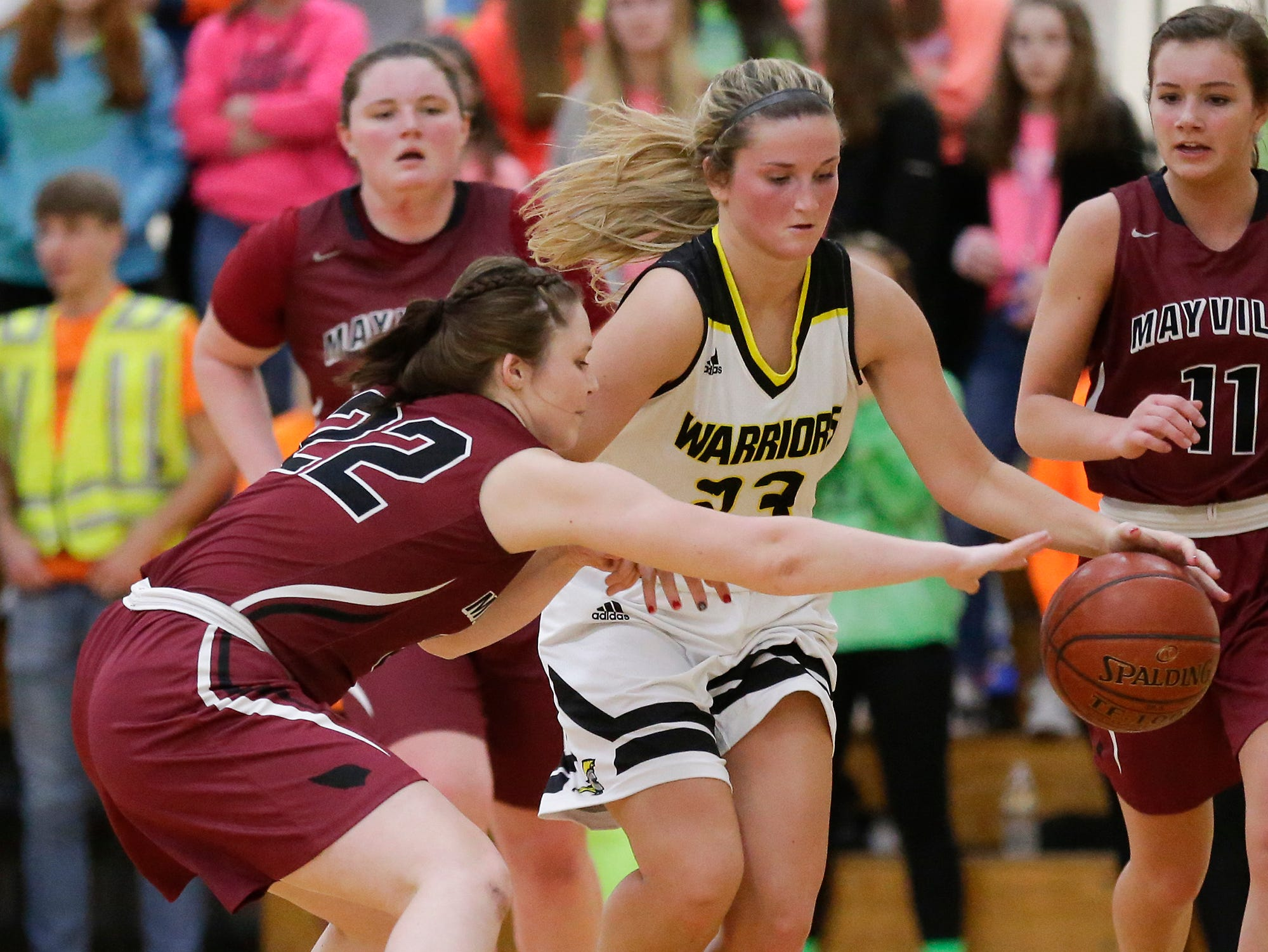 Mayville High School girls basketball's Reannah Zimmer (22) attempts to steal the ball from Waupun High School's Claire Harder (23) Saturday, February 23, 2019 during their WIAA Division 4 sectional quarterfinal game in Waupun. Waupun won the game 62-45. Doug Raflik/USA TODAY NETWORK-Wisconsin