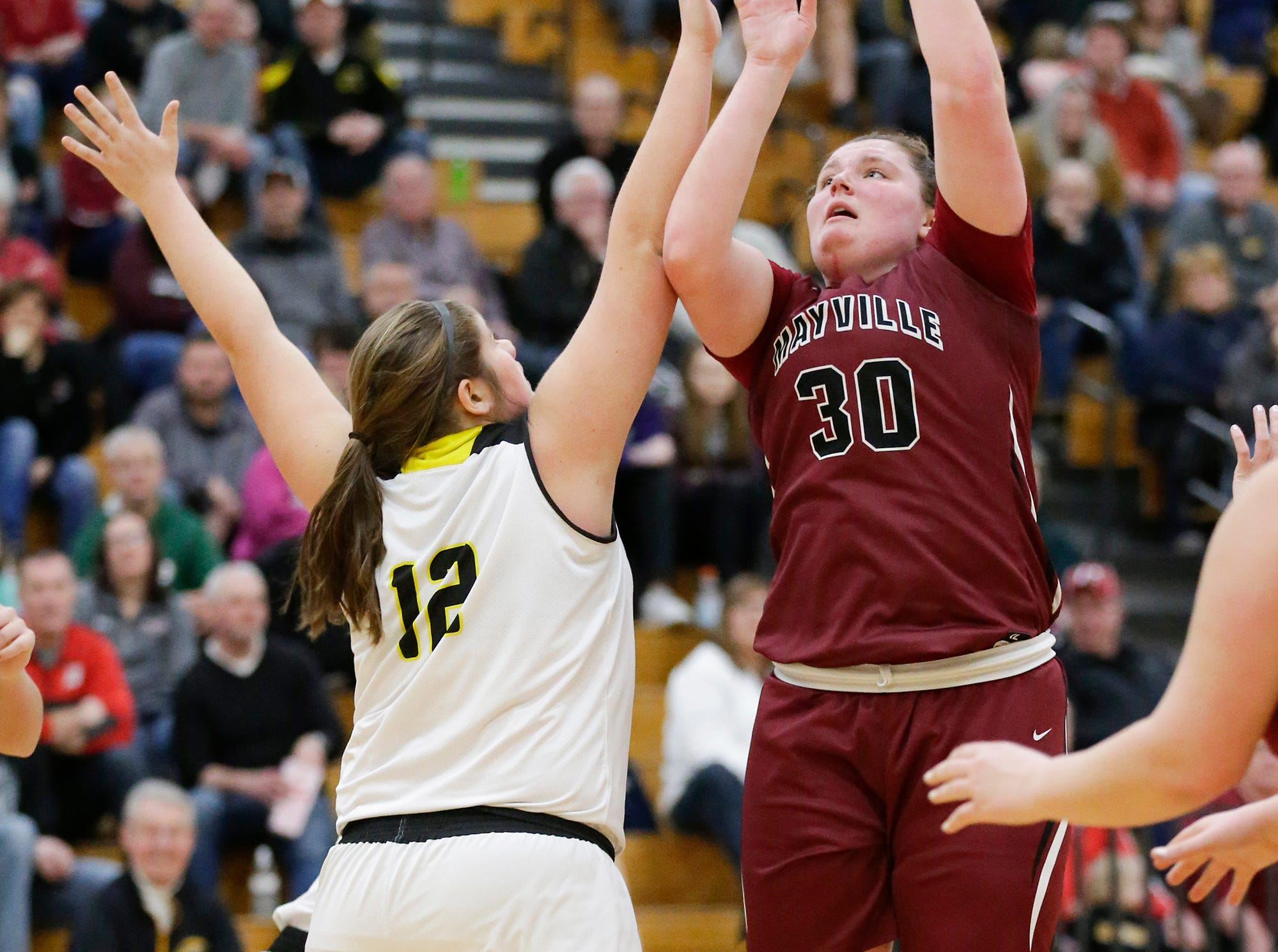 Mayville High School girls basketball's Sydney Schultz (30) shoots a basket over Waupun High School's Kelli Bonack (12) Saturday, February 23, 2019 during their WIAA Division 4 sectional quarterfinal game in Waupun. Waupun won the game 62-45. Doug Raflik/USA TODAY NETWORK-Wisconsin