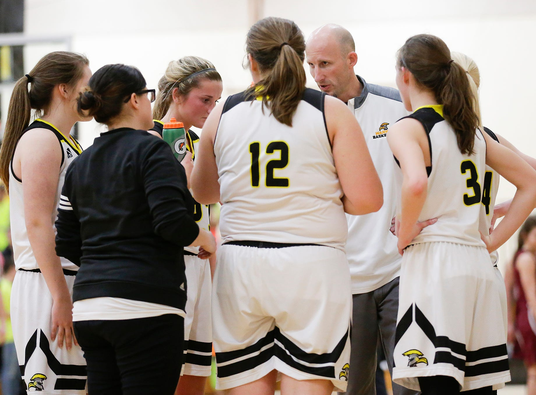 Waupun High School girls basketball coach Tim Aalsma talks to his team during a time out during a Saturday, February 23, 2019 during their WIAA Division 4 sectional quarterfinal game against Mayville High School in Waupun. Waupun won the game 62-45. Doug Raflik/USA TODAY NETWORK-Wisconsin