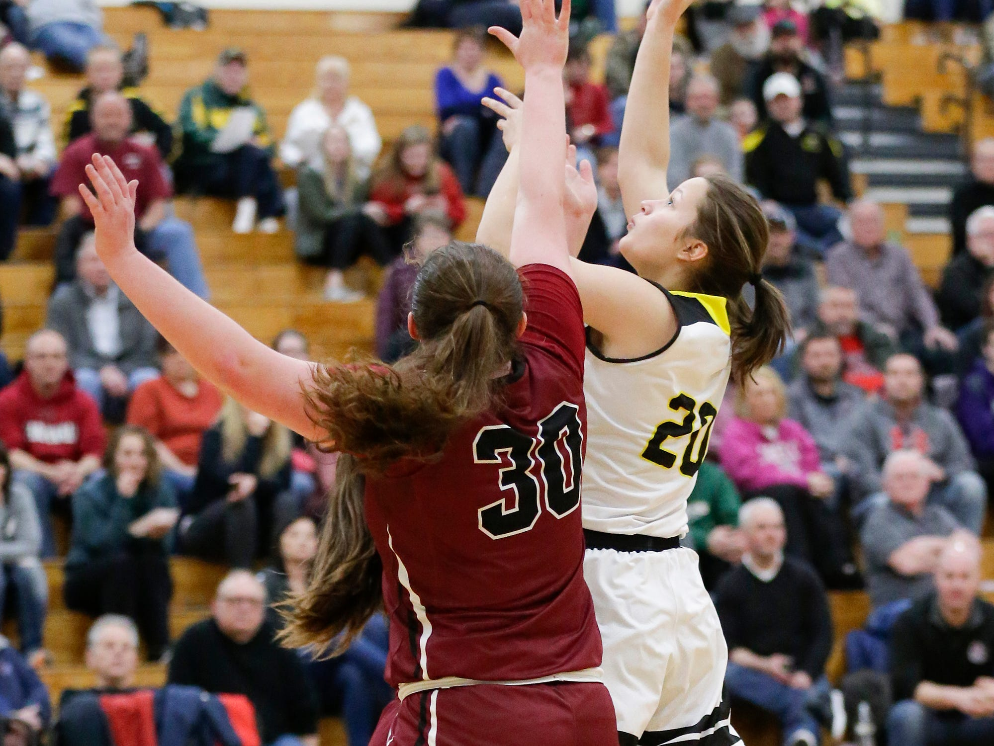 Waupun High School girls basketball's Gaby Matamoros (20) goes up for a shot against Mayville High School's Sydney Schultz (30) Saturday, February 23, 2019 during their WIAA Division 4 sectional quarterfinal game in Waupun. Waupun won the game 62-45. Doug Raflik/USA TODAY NETWORK-Wisconsin