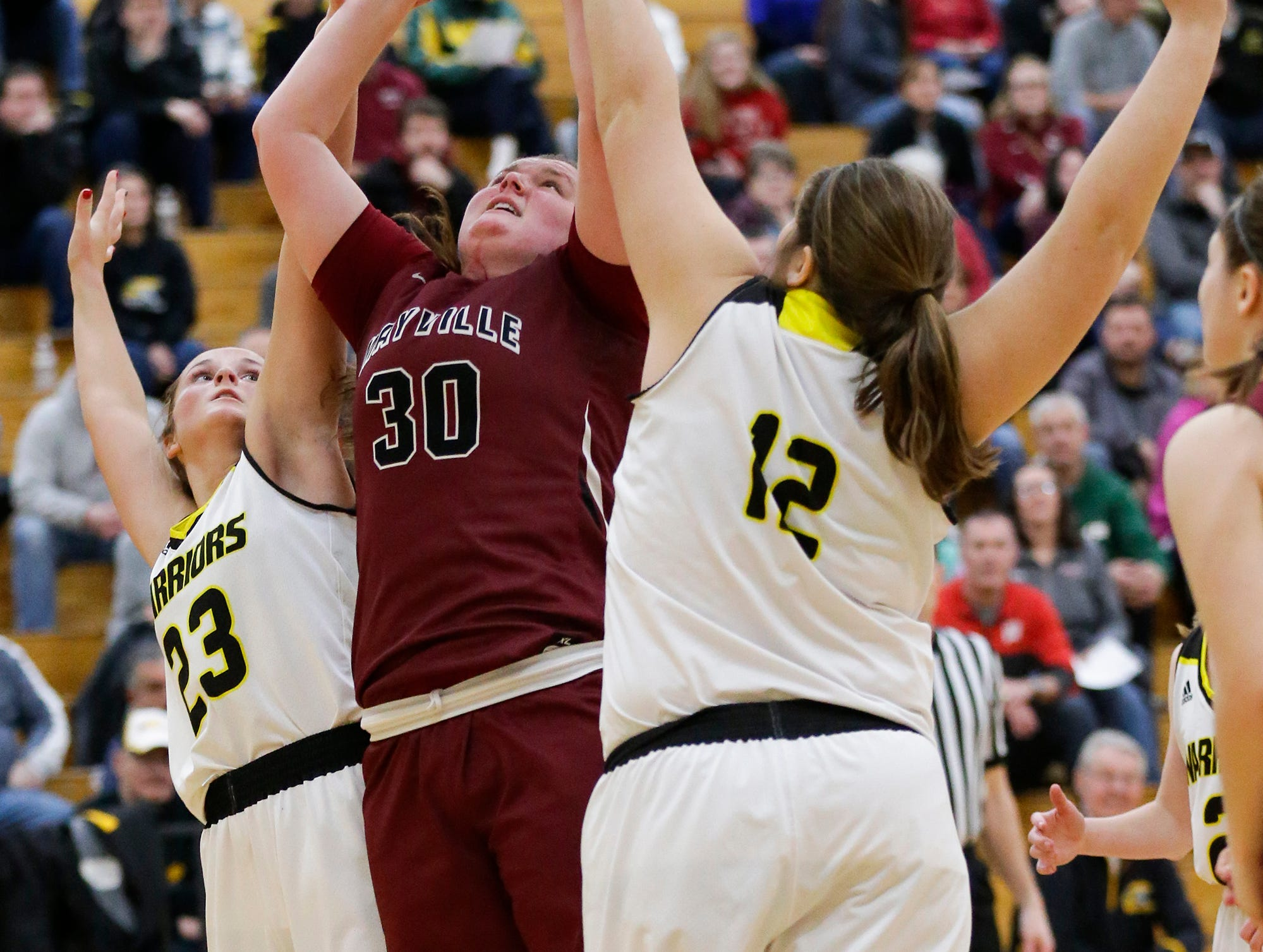 Waupun High School girls basketball's Claire Harder (23) and Kelli Bonack (12) defend against Mayville High School's Sydney Schultz (30) Saturday, February 23, 2019 during their WIAA Division 4 sectional quarterfinal game in Waupun. Waupun won the game 62-45. Doug Raflik/USA TODAY NETWORK-Wisconsin