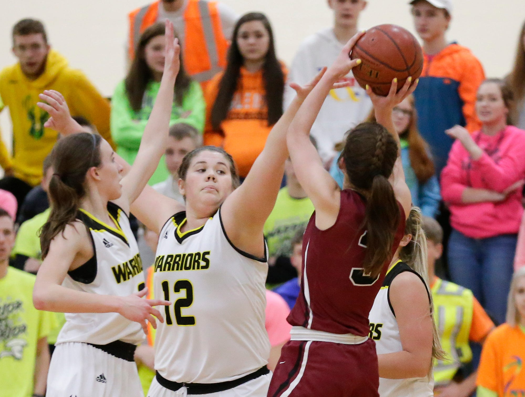 Mayville High School girls basketball's Amber Schraufnagel is defended by Waupun High School's Abbie Aalsma (3) and Kelli Bonack (12) Saturday, February 23, 2019 during their WIAA Division 4 sectional quarterfinal game in Waupun. Waupun won the game 62-45. Doug Raflik/USA TODAY NETWORK-Wisconsin