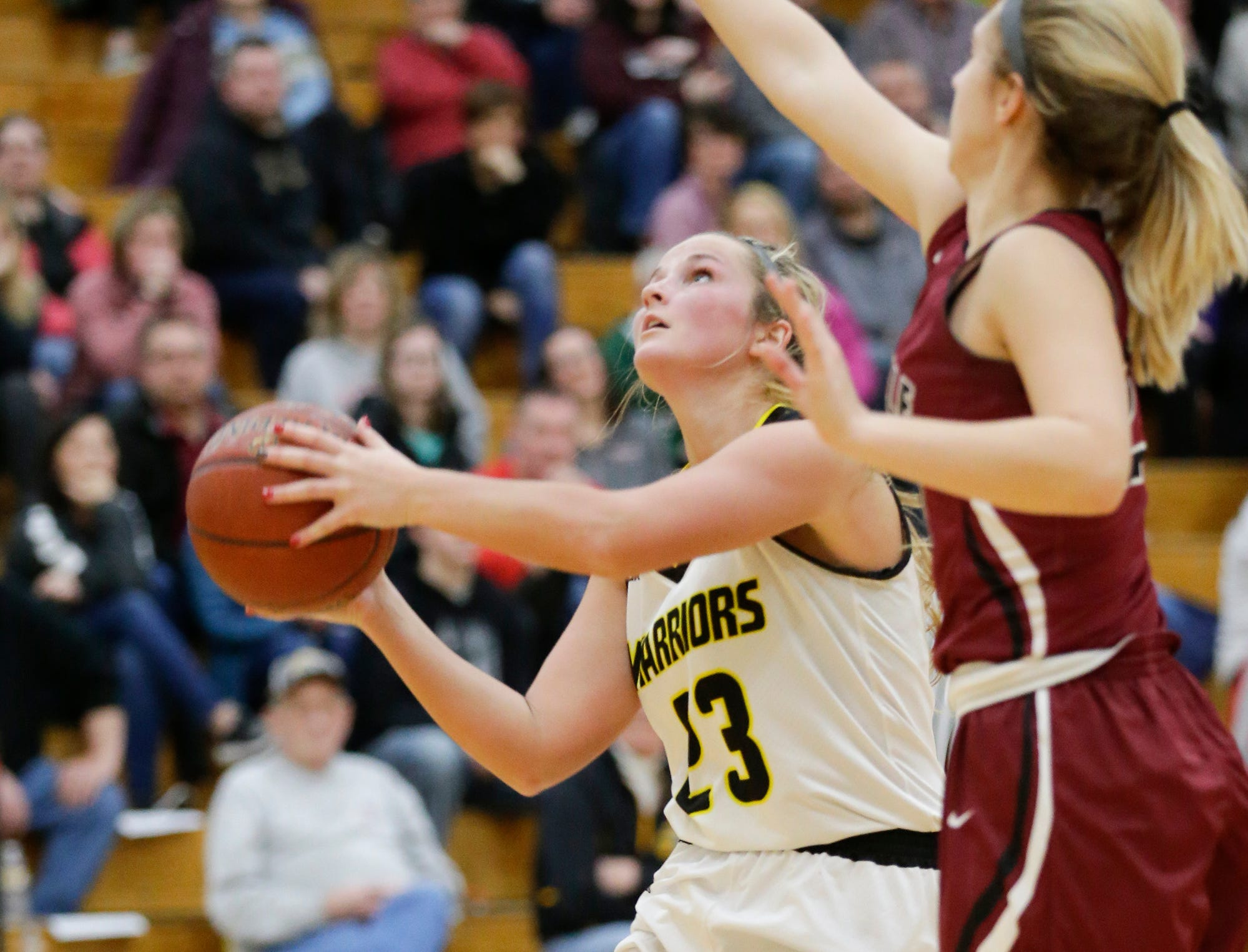 Waupun High School girls basketball's Claire Harder (23) moves in for a basket while being defended by Mayville High School's Chloe Welak (21) Saturday, February 23, 2019 during their WIAA Division 4 sectional quarterfinal game in Waupun. Waupun won the game 62-45. Doug Raflik/USA TODAY NETWORK-Wisconsin