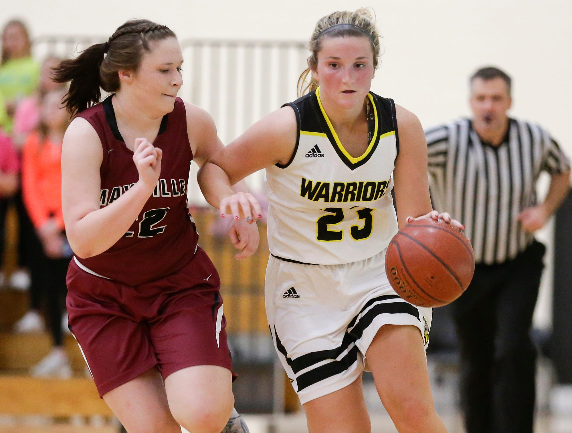 Waupun High School girls basketball's Claire Harder works her way down the court with Mayville High School's Reannah Zimmer Saturday, February 23, 2019 during their WIAA Division 4 sectional quarterfinal game in Waupun. Waupun won the game 62-45. Doug Raflik/USA TODAY NETWORK-Wisconsin