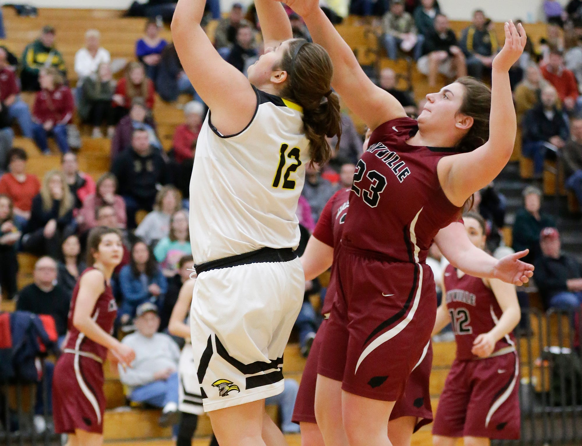 Waupun High School girls basketball's Kelli Bonack (12) attempts a shot while being defended by Mayville High School's Makenzie Perry (23) Saturday, February 23, 2019 during their WIAA Division 4 sectional quarterfinal game in Waupun. Waupun won the game 62-45. Doug Raflik/USA TODAY NETWORK-Wisconsin