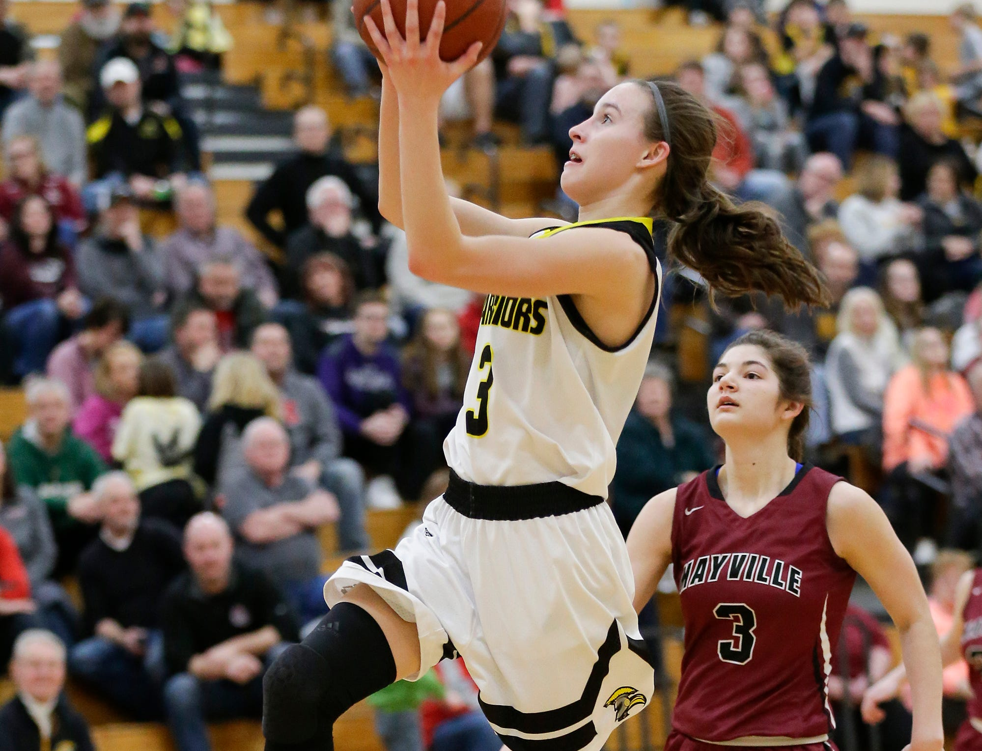 Waupun High School girls basketball's Abbie Aalsma goes up for a basket against Mayville High School Saturday, February 23, 2019 during their WIAA Division 4 sectional quarterfinal game in Waupun. Waupun won the game 62-45. Doug Raflik/USA TODAY NETWORK-Wisconsin