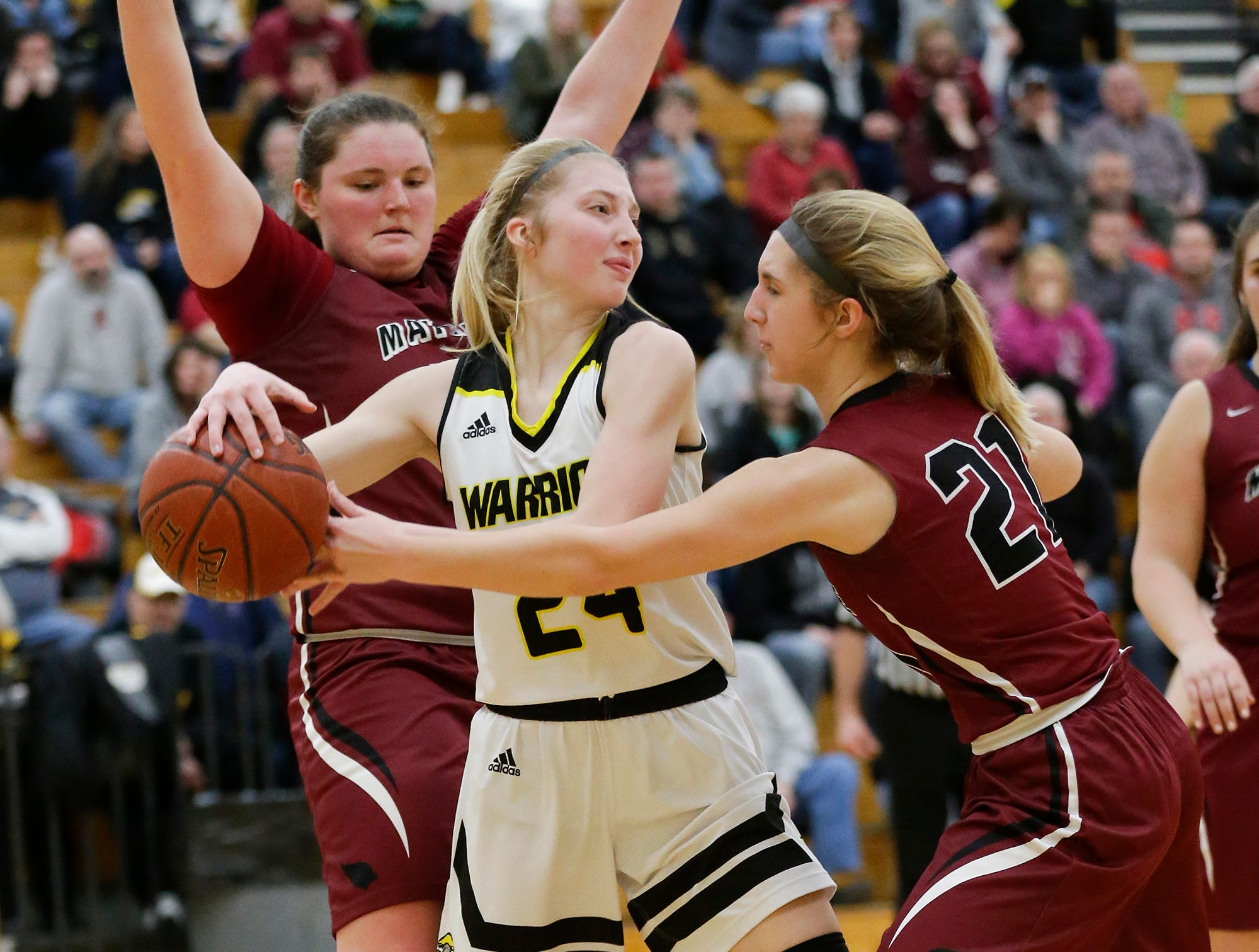 Waupun High School girls basketball's Peyton McGinnis (24) is defended by Mayville High School's Sydney Schultz (30) and Chloe Welak (21) Saturday, February 23, 2019 during their WIAA Division 4 sectional quarterfinal game in Waupun. Waupun won the game 62-45. Doug Raflik/USA TODAY NETWORK-Wisconsin