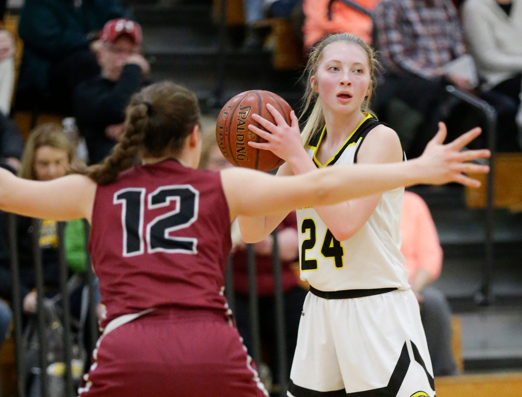 Waupun High School girls basketball's Peyton McGinnis (24) looks to pass the ball against Mayville High School's Alaina Wagner (12) Saturday, February 23, 2019 during their WIAA Division 4 sectional quarterfinal game in Waupun. Waupun won the game 62-45. Doug Raflik/USA TODAY NETWORK-Wisconsin
