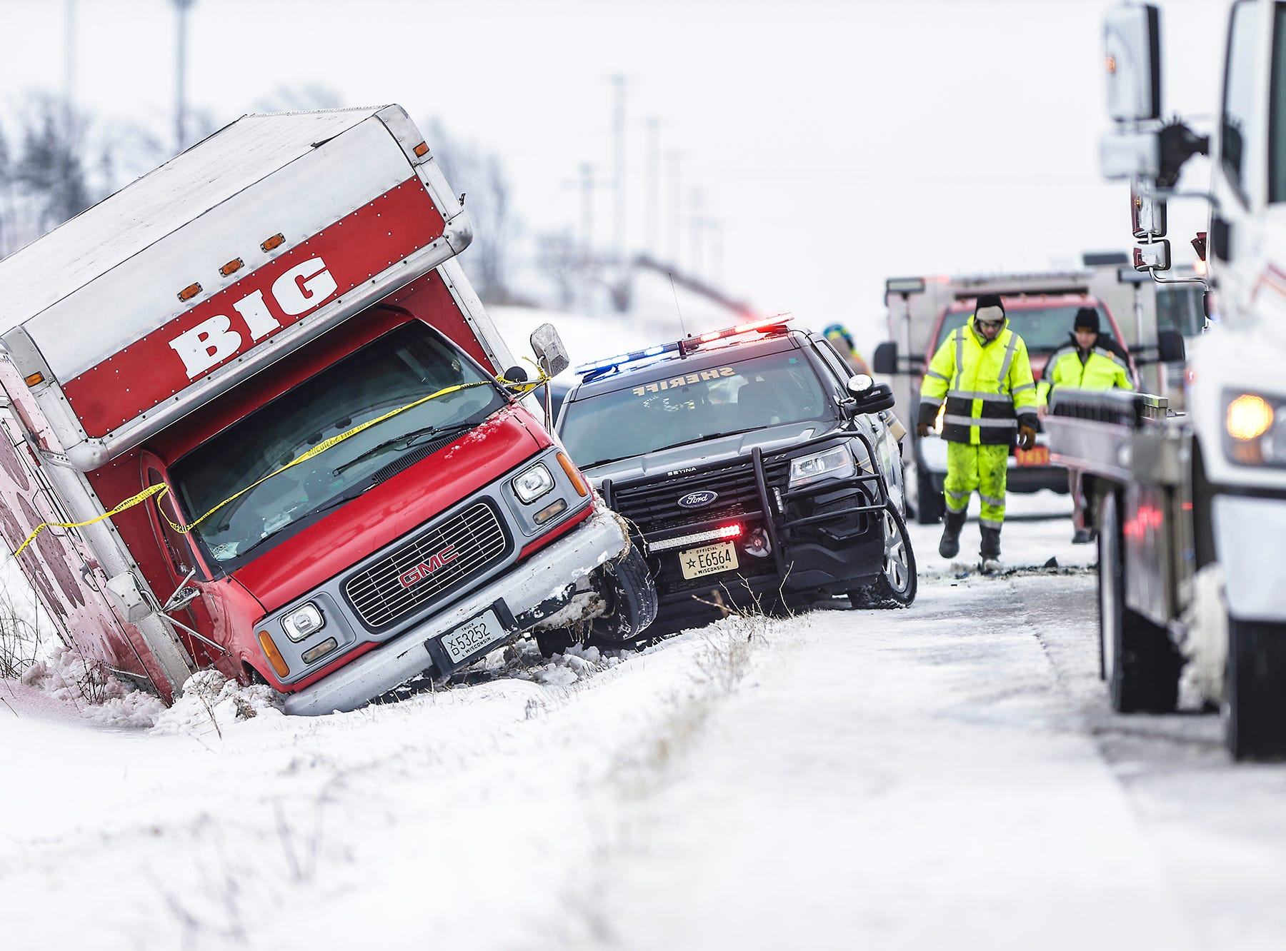 Emergency crews work the scene of a 3 vehicle crash, including a Fond du Lac County Sheriff's Office squad car, Sunday, February 24, 2019, on Interstate 41 near County Highway F south of Fond du Lac, Wisconsin. Doug Raflik/USA TODAY NETWORK-Wisconsin