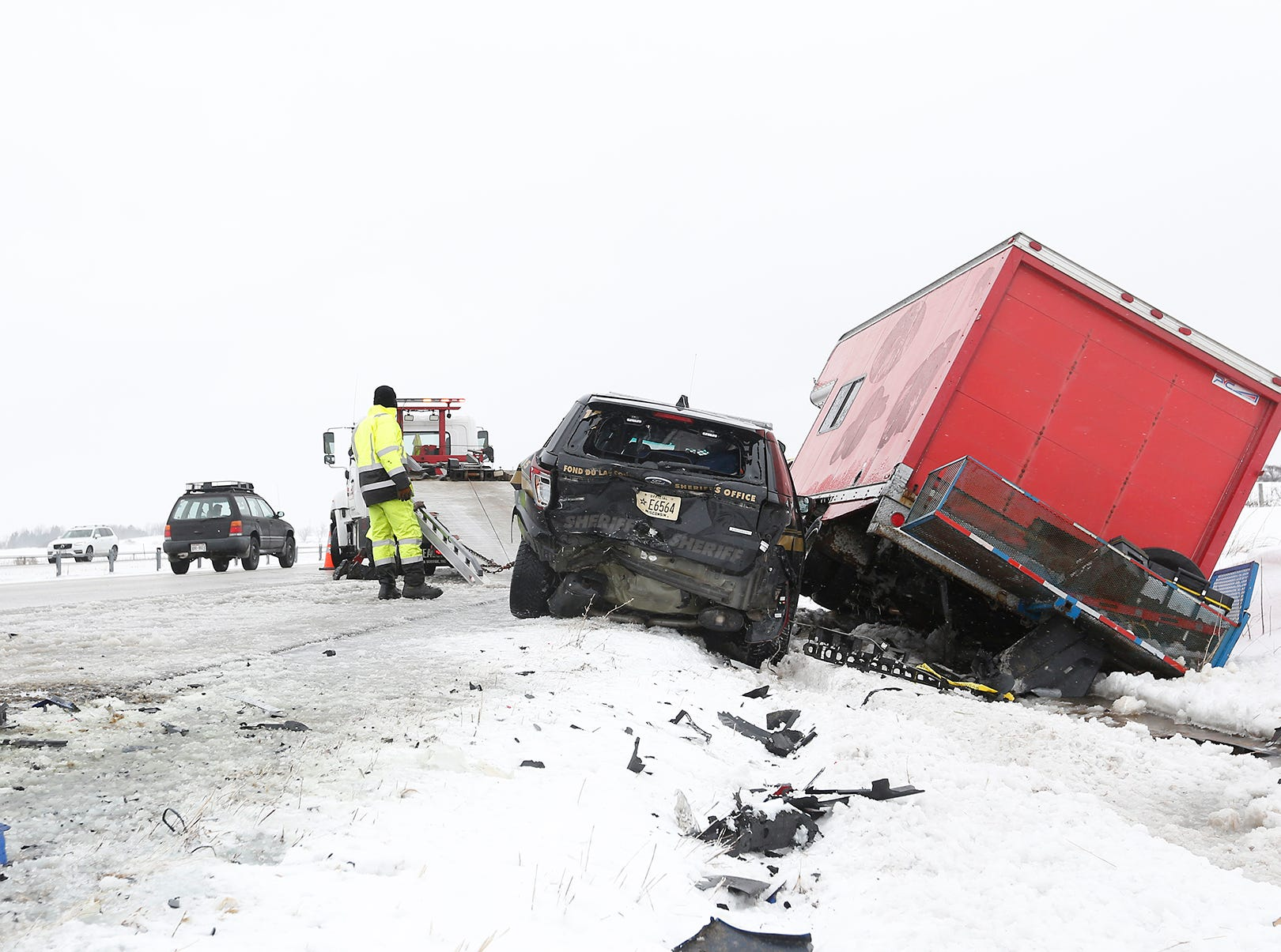 A tow truck operator gets ready to load up a Fond du Lac County Sheriff's Office squad car that was involved in a 3 vehicle crash Sunday, February 24, 2019 on I-41 near County Highway F, south of Fond du Lac, Wisconsin. High winds and blowing snow caused near white-out conditions in parts of the state. Doug Raflik/USA TODAY NETWORK-Wisconsin