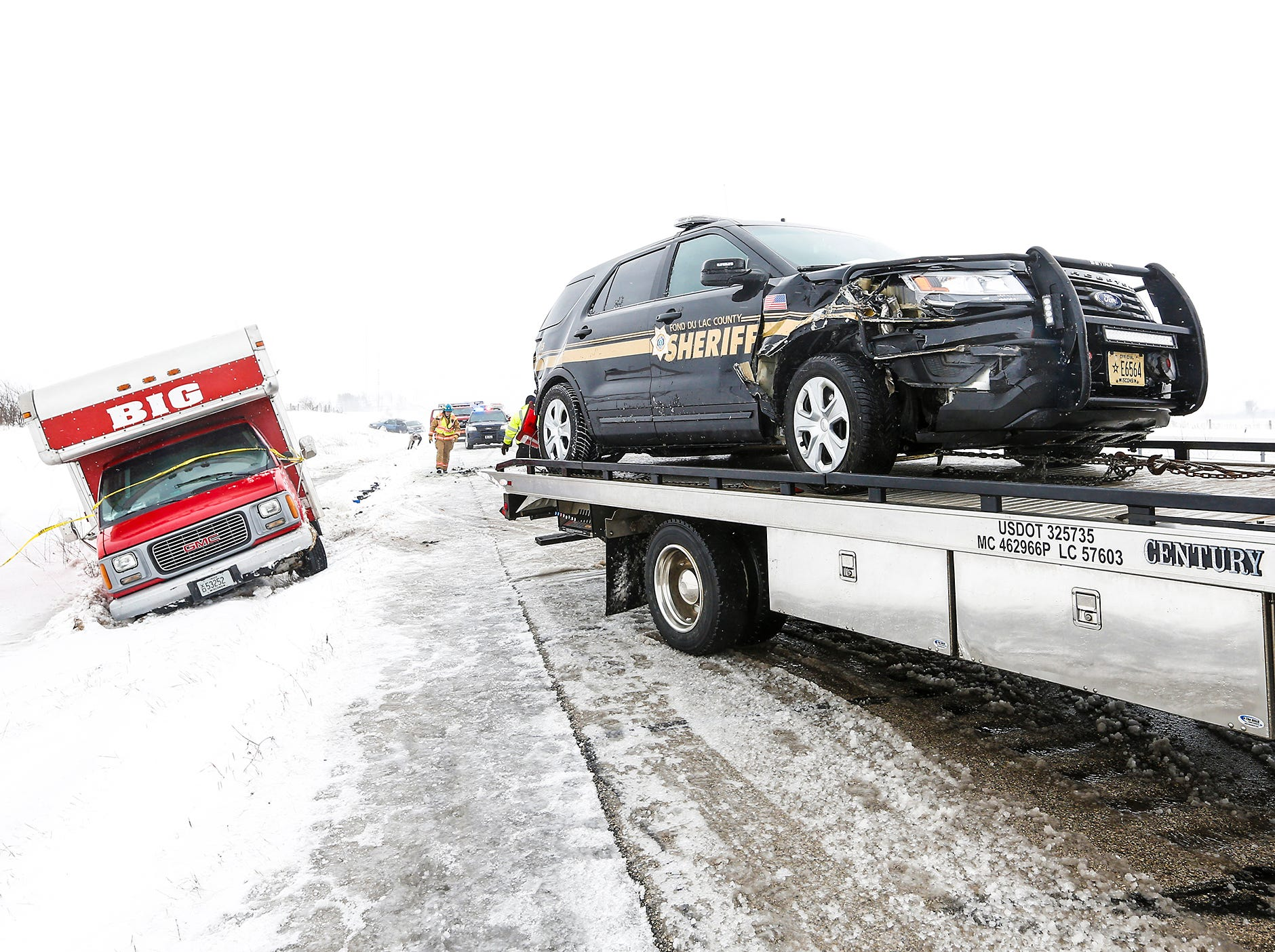 A Fond du Lac County Sheriff's Office squad car sits on a tow truck after it was involved in a 3 vehicle crash Sunday, February 24, 2019 on I-41 near County Highway F, south of Fond du Lac, Wisconsin. High winds and blowing snow caused near white-out conditions in parts of the state. Doug Raflik/USA TODAY NETWORK-Wisconsin