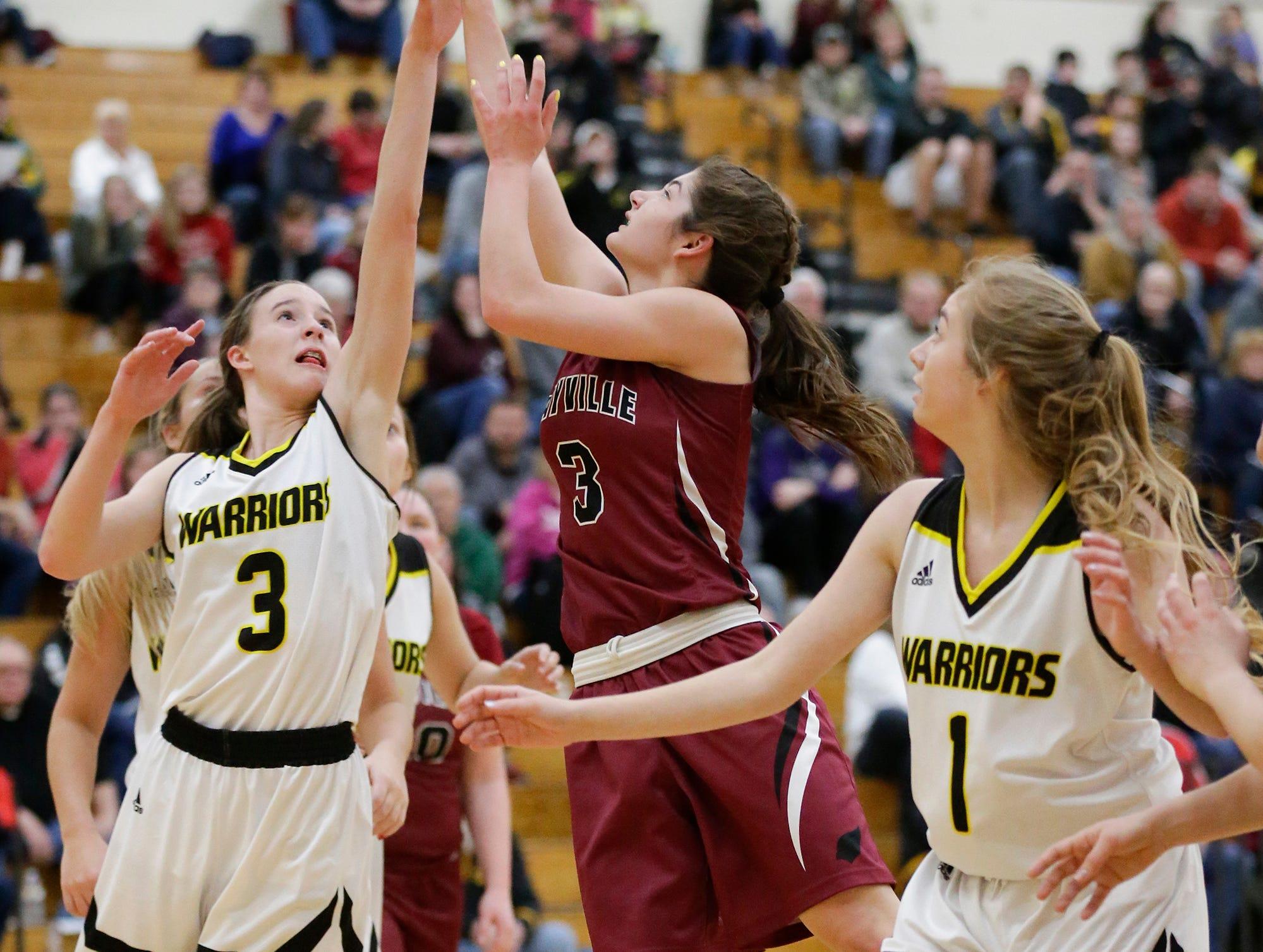 Mayville High School girls basketball's Amber Schraufnagel (3) shoots a basket against Waupun High School's Abbie Aalsma (3) Saturday, February 23, 2019 during their WIAA Division 4 sectional quarterfinal game in Waupun. Waupun won the game 62-45. Doug Raflik/USA TODAY NETWORK-Wisconsin