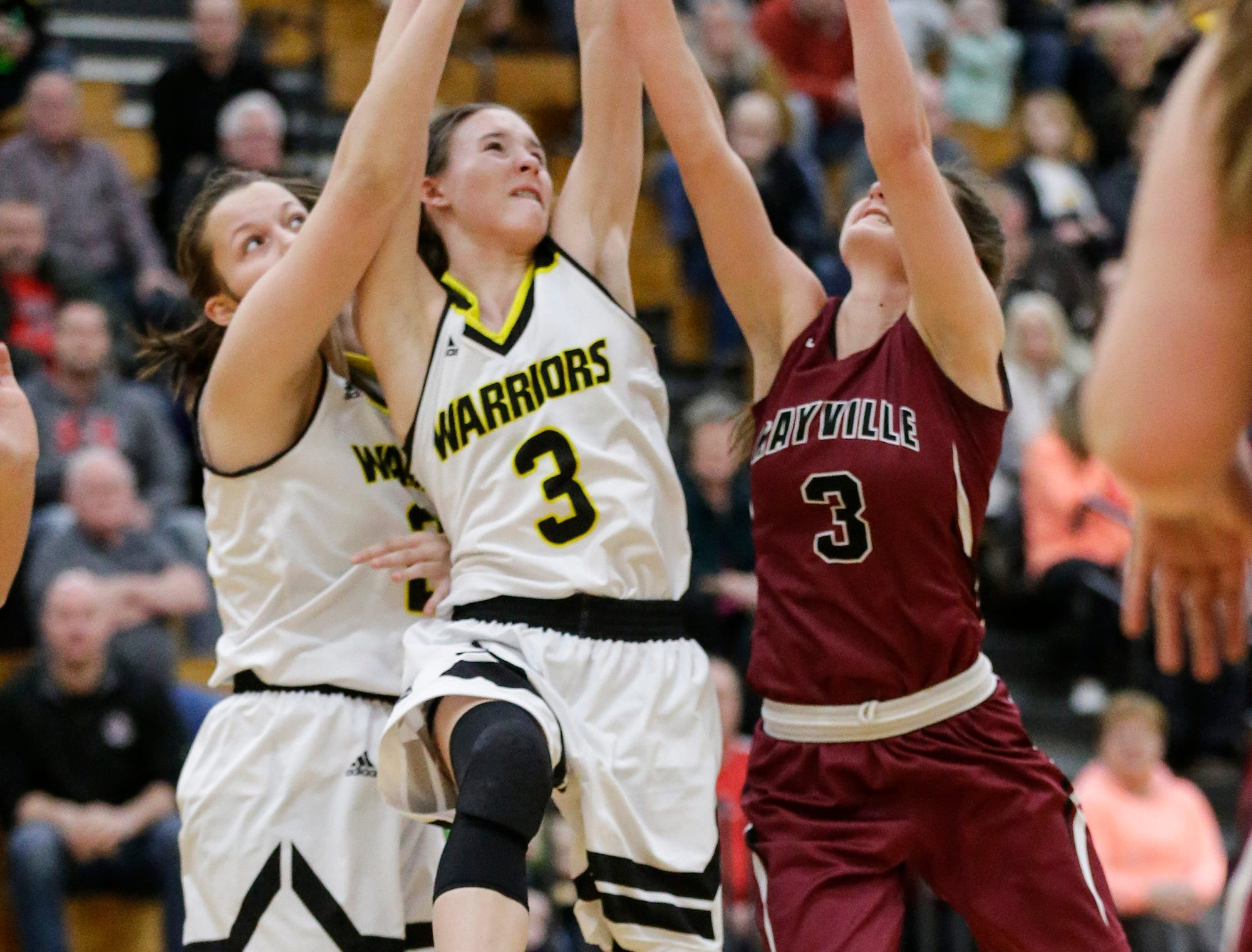 Waupun High School girls basketball's Gaby Matamoros (20) and Abbie Aalsma (3) reach for a rebound with Mayville High School's Amber Schraufnagel (3) Saturday, February 23, 2019 during their WIAA Division 4 sectional quarterfinal game in Waupun. Waupun won the game 62-45. Doug Raflik/USA TODAY NETWORK-Wisconsin