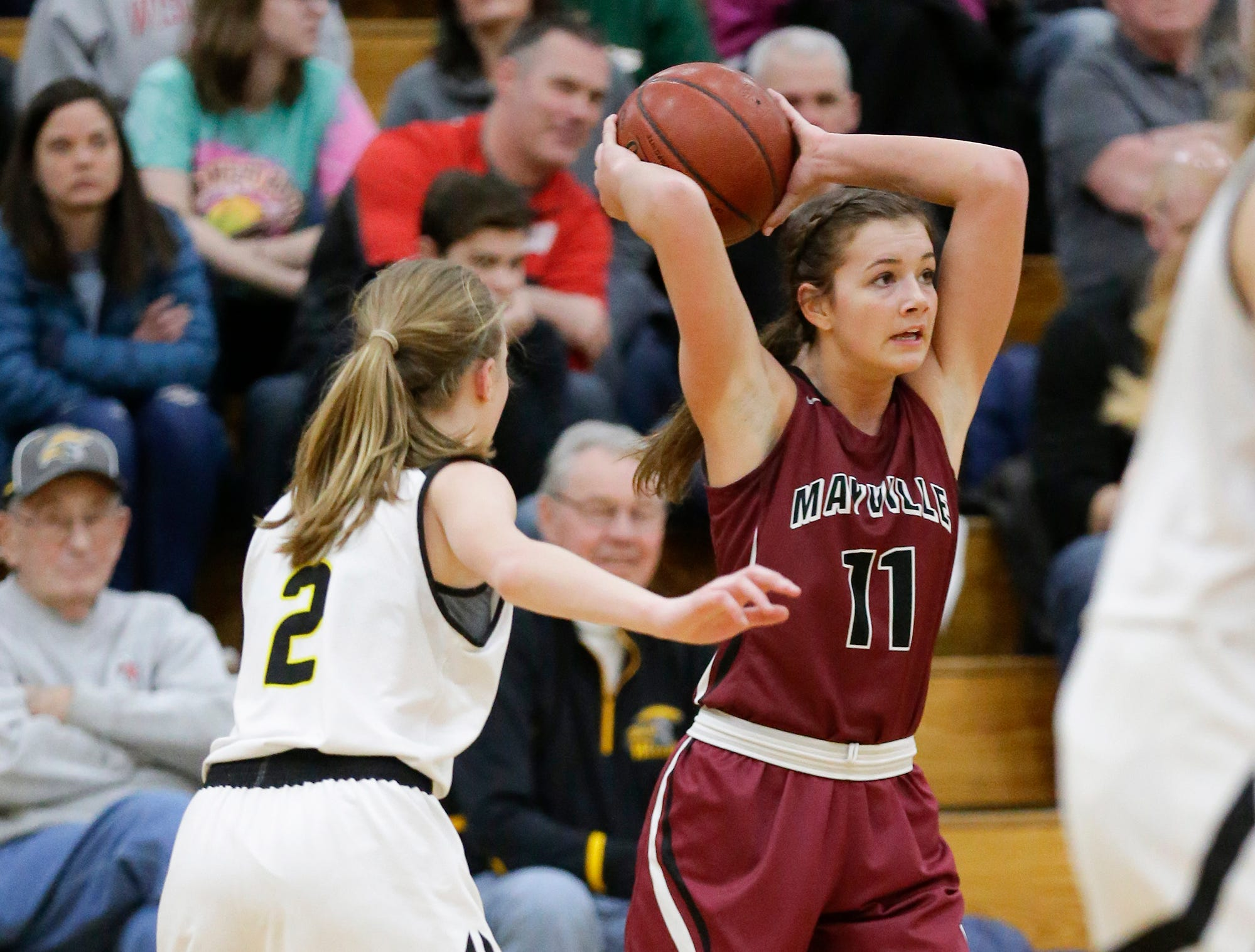 Mayville High School girls basketball's Whitney Liegl passes the ball while defended by Waupun High School's Naomi Aalsma (2) Saturday, February 23, 2019 during their WIAA Division 4 sectional quarterfinal game in Waupun. Waupun won the game 62-45. Doug Raflik/USA TODAY NETWORK-Wisconsin