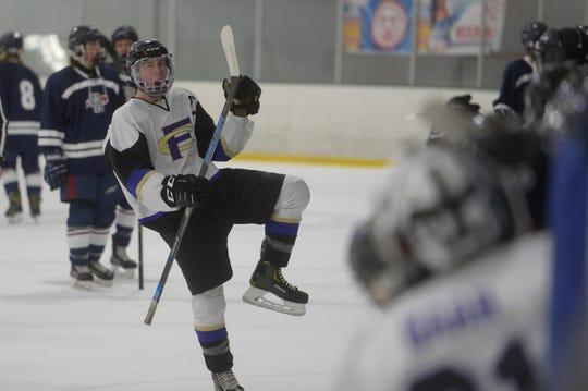 Fort Collins hockey player Chris Frauenknecht celebrates a goal during a quarterfinal hockey game against Dakota Ridge at NoCo Ice Center on Saturday, Feb. 23. Dakota Ridge won 8-6.