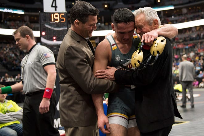 Windsor High School junior Isaiah Salazar hug coaches Monte Trusty, left, and Milo Trusty after beating Pueblo's Jayson Davis in the class 4A 195 pound championship match on Saturday, Feb. 23, 2019. Salazar has verbally committed to Minnesota.