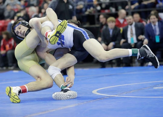 Wrightstown's Ben Durocher wrestles Two Rivers' Joey Bianchi in a Division 2 145-pound championship match Saturday at the WIAA state individual wrestling tournament at the Kohl Center in Madison.