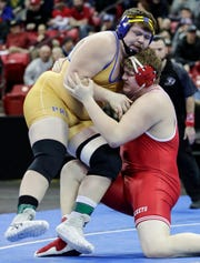 Spencer/Columbus Catholic's Logan Zschernitz takes down Mauston's Dom Meurett in the Division 2 285-pound weight class championship match during the WIAA state individual wrestling tournament at the Kohl Center Saturday, February 23, 2019, in Madison, Wis.