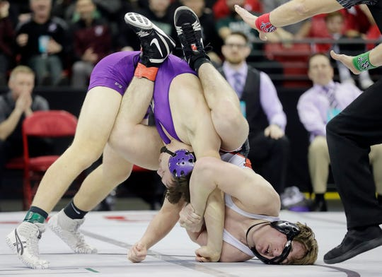 Marshfield's Sam Mitchell wrestles Stoughton's Brooks Empey in the Division 1 195-pound championship match Saturday at the WIAA state individual wrestling tournament at the Kohl Center in Madison.