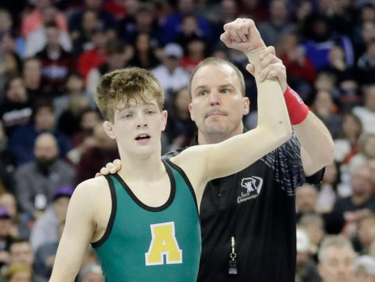 Ashwaubenon's Cody Minor defeated Mukwonago's Tyler Goebel in the Division 1 113-pound championship match Saturday at the WIAA state individual wrestling tournament at the Kohl Center in Madison.