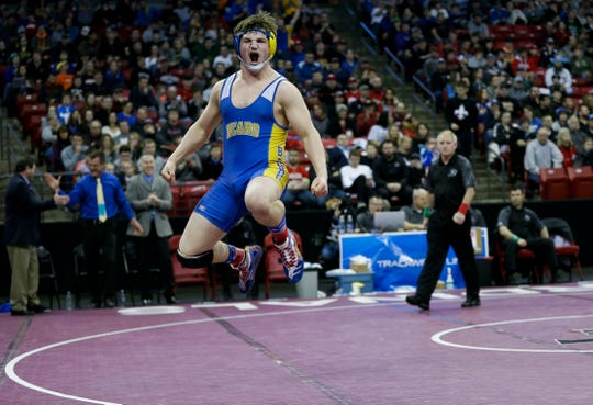 Bonduel's Jacob Giese celebrates after winning the Division 3 195-pound championship match Saturday during the WIAA state wrestling tournament at the Kohl Center in Madison.