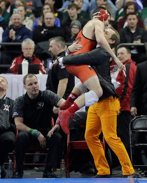 Oconto Falls' Clayton Whiting celebrates after defeating Amery's Mike Smith in the Division 2 152-pound championship match at the WIAA state individual wrestling tournament Saturday at the Kohl Center in Madison.