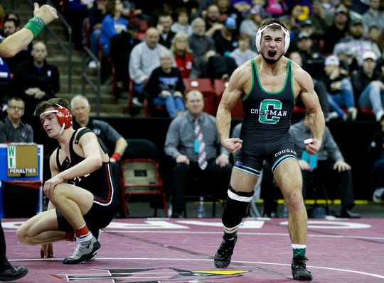 Coleman's Jake Baldwin celebrates after beating Cochrane-Fountain City's Max Dasher to win the Division 3 145-pound championship match during the WIAA state wrestling tournament on Saturday, February 23, 2019, at the Kohl Center in Madison, Wis.