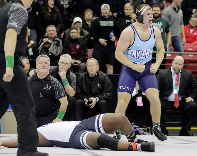 Bay Port's Max Meeuwsen celebrates victory over Janesville Craig's Keeanu Benton in the Division 1 285-pound championship match Saturday at the WIAA state individual wrestling tournament at the Kohl Center in Madison.
