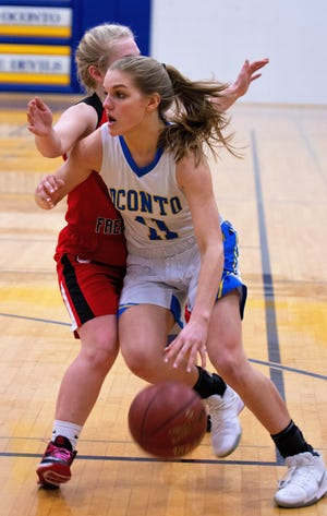 Oconto's Jenna Hornblad penetrates to the basket and scores late in the second half in the regional game against Weyauwega-Fremont in Oconto on Feb. 19.