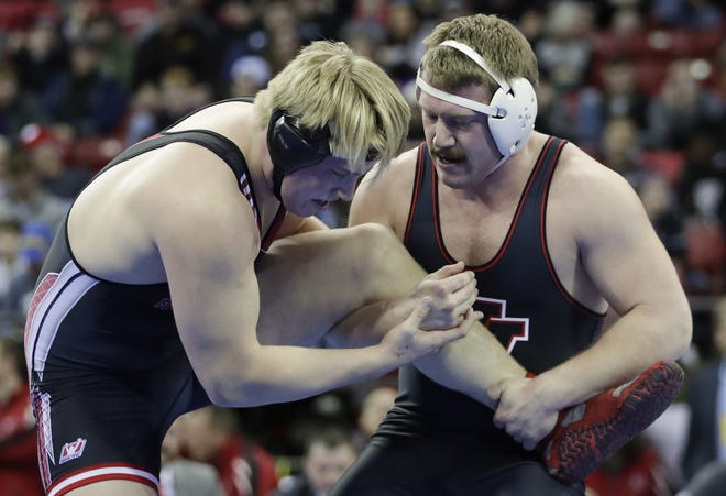 Valders' Jackson Linsmeier tries to take down Medford's Jake Rau in the Division 2 220-pound championship match during the WIAA state individual wrestling tournament Saturday at the Kohl Center in Madison.