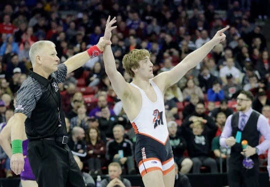 Marshfield's Sam Mitchell celebrates after winning the Division 1 195-pound championship match Saturday at the WIAA state individual wrestling tournament at the Kohl Center in Madison.