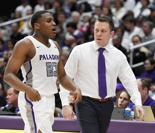 Furman head coach Bob Richey speaks with Furman's Jordan Lyons (23) Saturday, February 23, 2019 at Timmons Arena.