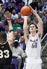 The new 3-point distance could open up options Furman's Clay Mounce (45), one of the Southern Conference's top outside shooters but also adept at slashing to the basket.
