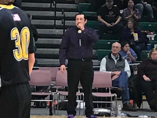 Hays-Lodgepole head coach Derrick Shambo watches as his team comes out of a timeout during Sunday's Northern C boys' challenge game against Winnett-Grass Range at Four Seasons Arena.