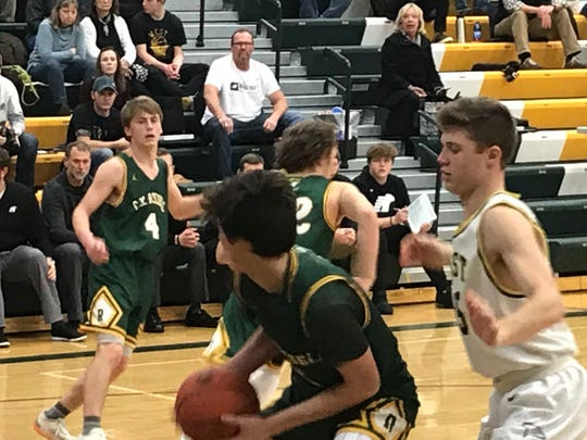 CMR's Brenden Lindseth, front, looks toward teammate Bryce Nelson for an outlet after grabbing a rebound Saturday against Billings West at the CMR Fieldhouse.