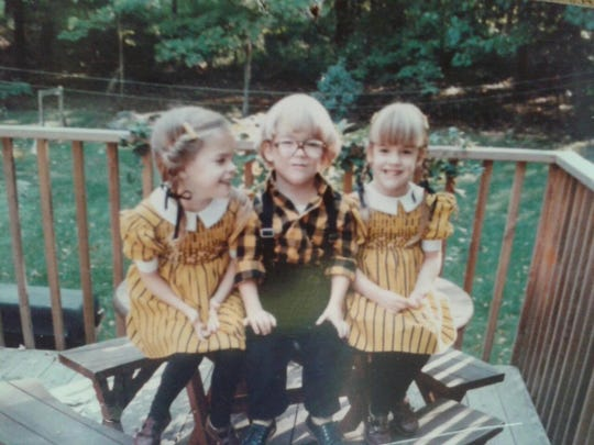 "Derek Schultz, middle, was ""such a patient boy growing up,"" his mom Mary Schultz said."